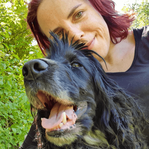 Dr Kat Arney with her dog Ferdy